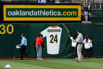 OAKLAND, CA - AUGUST 01:  Hall of Fame baseball player Rickey Henderson's retired jersey is unveiled during a ceremony to retire his number 24 by the Oakland Athletics before the start of the game against the Toronto Blue Jays August 1, 2009 at the McAfee
