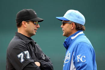 KANSAS CITY, MO - MAY 13:  Manager Trey Hillman #88 of the Kansas City Royals exchanges words with first-base umpire Jim Reynolds #77 during the game against the Cleveland Indians on May 13, 2010 at Kauffman Stadium in Kansas City, Missouri.  (Photo by Ja