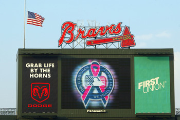 ATLANTA - SEPTEMBER 11:  Detail of the commemorative logo on the jumbotron honoring the victims of the 9-11-01 terror attacks before the second game of a MLB double-header between the Atlanta Braves and the New York Mets on September 11, 2002 at Turner Fi