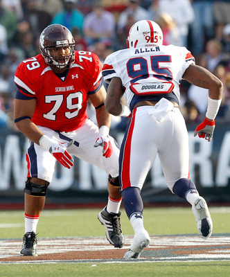 MOBILE, AL - JANUARY 29:Offensive lineman Derek Sharrod #79 of the South Team matches up with Pierre Allen #95 of the North Team during the second quarter of the Under Armour Senior Bowl on January 29, 2011 at Ladd-Pebbles Stadium in Mobile, Alabama. (Pho