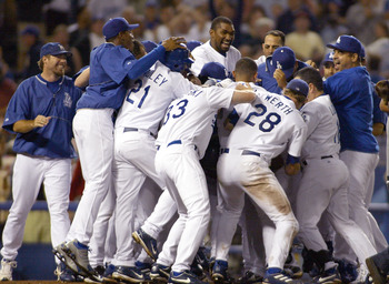 LOS ANGELES - JULY 23:  The Dodgers celebrate defeating the San Diego Padres, after the game winning home run was hit by Adrian Beltre #29 of the Los Angeles Dodgers in the ninth inning, on July 23, 2004 at Dodger Stadium in Los Angeles, California.  (Pho