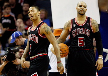 CHARLOTTE, NC - JANUARY 12:  Teammates Derrick Rose #1 and Carlos Boozer #5 of the Chicago Bulls reacts after a  play against the Charlotte Bobcats during their game at Time Warner Cable Arena on January 12, 2011 in Charlotte, North Carolina. NOTE TO USER