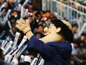 BEIJING - MARCH 16:  Swinging Friar, the San Diego Padres mascot, waves to crowd during the second game between the Los Angeles Dodgers and the San Diego Padres at Beijing's Wukesong Stadium on March 16, 2008 in Beijing, China. The Padres played against t