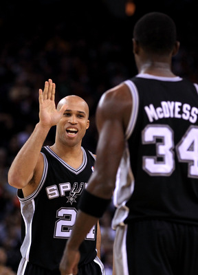 OAKLAND, CA - JANUARY 24:  Richard Jefferson #24 of the San Antonio Spurs congratulates Antonio McDyess #34 during their game against the Golden State Warriors at Oracle Arena on January 24, 2011 in Oakland, California.  NOTE TO USER: User expressly ackno