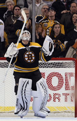 BOSTON, MA - JANUARY 11:  Tim Thomas #30 of the Boston Bruins celebrates after he shut out the Ottawa Senators on January 11, 2011 at the TD Garden in Boston, Massachusetts. The Bruins defeated the Senators 6-0.  (Photo by Elsa/Getty Images)