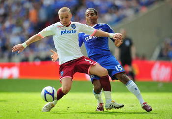 LONDON, ENGLAND - MAY 15:  Jamie O'Hara of Portsmouth tussles for posession with Florent Malouda of Chelsea during the FA Cup sponsored by E.ON Final match between Chelsea and Portsmouth at Wembley Stadium on May 15, 2010 in London, England.  (Photo by Cl