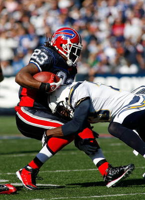 ORCHARD PARK, NY - OCTOBER 19:  Marshawn Lynch #23 of the Buffalo Bills is tackled by Quentin Jammer #23 of the San Diego Chargers on October 19, 2008 at Ralph Wilson Stadium in Orchard Park, New York. Buffalo won 23-14.  (Photo by Rick Stewart/Getty Imag