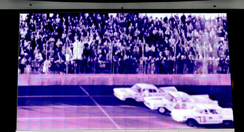 CHARLOTTE, NC - OCTOBER 13:   An image of the finish of the first Daytona 500 showing Lee Petty as the winner is shown on the jumbotron during NASCAR Hall of Fame Voting Day at the NASCAR Hall of Fame on October 13, 2010 in Charlotte, North Carolina.  (Ph