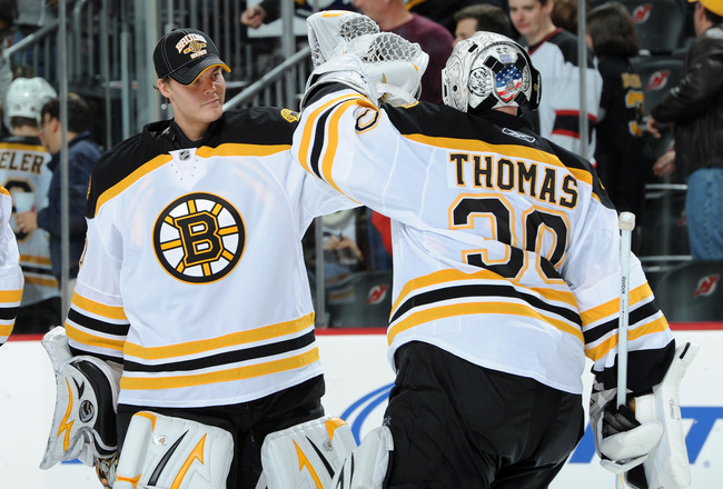 NEWARK, NJ - OCTOBER 16: Tim Thomas #30 of the Boston Bruins is congratulated by Tuukka Rask #40 of the Boston Bruins after the Boston Bruins defeated the New Jersey Devils 4-1 at the Prudential Center on October 16, 2010 in Newark, New Jersey. (Photo by