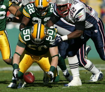 GREEN BAY, WI - NOVEMBER 19:  A.J. Hawk #50 of the Green Bay Packers drops to recover a fumble as teammate Marquand Manuel #22 and Daniel Graham #82 of the New England Patriots chases down the play on November 19, 2006 at Lambeau Field in Green Bay, Wisco