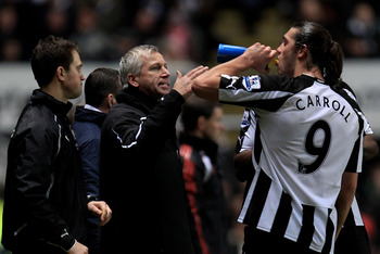 NEWCASTLE UPON TYNE, ENGLAND - DECEMBER 11:  Newcastle United Manager Alan Pardew issues instructions to Andy Carroll of Newcastle United during the Barclays Premier League match between Newcastle United and Liverpool at St James' Park on December 11, 201