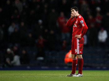 BLACKBURN, ENGLAND - JANUARY 05:  Fernando Torres of Liverpool dejected during a Barclays Premier league match betweem Blackburn Rovers and Liverpool at Ewood park on January 5, 2011 in Blackburn, England.  (Photo by Clive Brunskill/Getty Images)