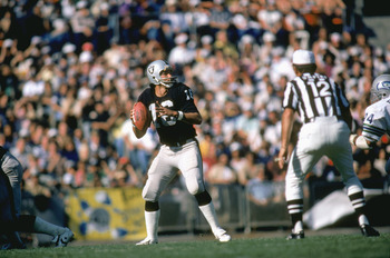 LOS ANGELES, CA - UNDATED:  Quarterback Jim Plunkett #16 of the Los Angeles Raiders falls back to pass during a NFL game against the Seattle Seahawks at Los Angeles Coliseum in Los Angeles, California. Jim Plunkett played for the Los Angeles Raiders from