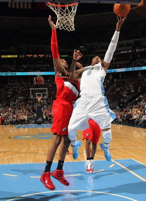 DENVER - DECEMBER 28:  J.R. Smith #5 of the Denver Nuggets takes a shot against the defense of LaMarcus Aldridge #12 of the Portland Trail Blazers at Pepsi Center on December 28, 2010 in Denver, Colorado. The Nuggets defeated the Blazers 95-77. NOTE TO US