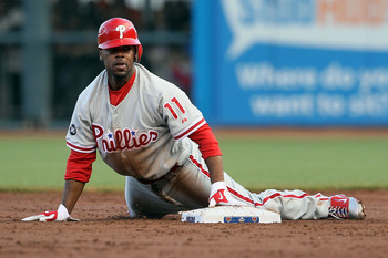 SAN FRANCISCO - OCTOBER 20:  Jimmy Rollins #11 of the Philadelphia Phillies slides in to second base after being tagged out in the second inning during Game Four of the NLCS against the San Francisco Giants in the 2010 MLB Playoffs at AT&T Park on October