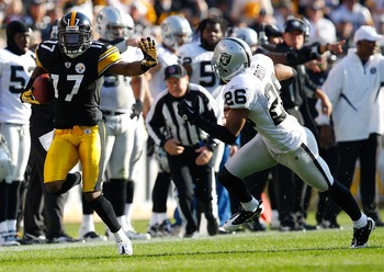 PITTSBURGH, PA - NOVEMBER 21:  Mike Wallace #17 of the Pittsburgh Steelers attempts to outrun a tackle by Stanford Routt #26 of the Oakland Raiders during the game on November 21, 2010 at Heinz Field in Pittsburgh, Pennsylvania.  (Photo by Jared Wickerham