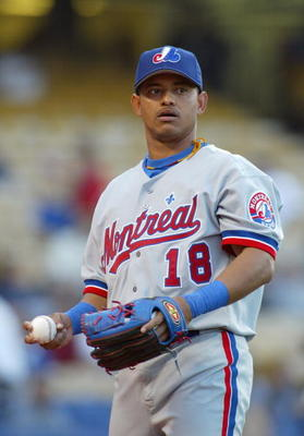 LOS ANGELES - APRIL 30:  Infielder Orlando Cabrera #18 of the Montreal Expos holds the ball during the game against the Los Angeles Dodgers at Dodger Stadium on April 30, 2004 in Los Angeles, California.  The Dodgers won 13-4.  (Photo by Lisa Blumenfeld/G