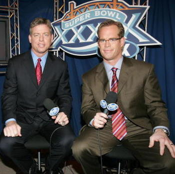 JACKSONVILLE, FL - FEBRUARY 06:  (L-R) FOX game broadcasters Cris Collinsworth, Troy Aiken and Joe Buck during the XXXIX Superbowl pregame show at Alltel Stadium on February 6, 2005 in Jacksonville, Florida.  (Photo by Frank Micelotta/Getty Images)