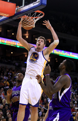 OAKLAND, CA - JANUARY 21:  David Lee #10 of the Golden State Warriors dunks the ball during their game against the Sacramento Kings at Oracle Arena on January 21, 2011 in Oakland, California. NOTE TO USER: User expressly acknowledges and agrees that, by d