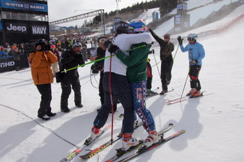 ASPEN, CO - JANUARY 30:  John Teller (white) of Mammoth Lakes, California is congratulated bby third place finisher Casey Puckett (green) of Aspen, Colorado in the Men's Skier X at Winter X Games 15 at Buttermilk Mountain on January 30, 2011 in Aspen, Col