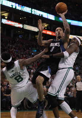BOSTON, MA - JANUARY 03:  Michael Beasley #8 of the Minnesota Timberwolves is called for an offensive foul as he drives to the net and knocks into Marquis Daniels #8 and Jermaine O'Neal #7 of the Boston Celtics on January 3, 2011 at the TD Garden in Bosto