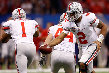 NEW ORLEANS, LA - JANUARY 04:  Quarterback Terrelle Pryor #2 of the Ohio State Buckeyes looks to hand the ball of to Dan Herron #1 against the Arkansas Razorbacks in the Sugar Bowl at the Louisiana Superdome on January 4, 2011 in New Orleans, Louisiana.