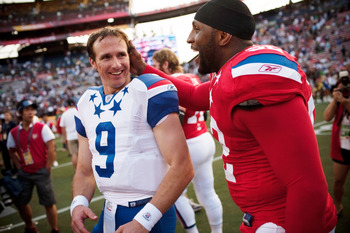 HONOLULU - JANUARY 30:  Drew Brees, #9 of the New Orleans Saints, shares a laugh with Devin McCourty, #32 of the New England Patriots, after the 2011 NFL Pro Bowl at Aloha Stadium on January 30, 2011 in Honolulu, Hawaii. NFC won 55-41 over the AFC. (Photo