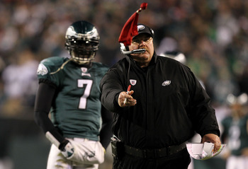 PHILADELPHIA, PA - DECEMBER 02:  Head coach Andy Reid of the Philadelphia Eagles throws the red challenge flag on a play involving Brent Celek #87 in the second half as Michael Vick #7 looks on against the Houston Texans at Lincoln Financial Field on Dece