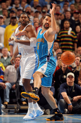 DENVER - APRIL 19:  Peja Stojakovic #16 of the New Orleans Hornets and Nene #31 of the Denver Nuggets vie for a loose ball in Game One of the Western Conference Quarterfinals during the 2009 NBA Playoffs at Pepsi Center on April 19, 2009 in Denver, Colora