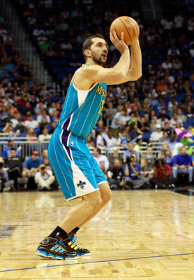 ORLANDO, FL - OCTOBER 10:  Peja Stojakovic #16 of the New Orleans Hornets attempts a shot during the game against the Orlando Magic at Amway Arena on October 10, 2010 in Orlando, Florida. NOTE TO USER: User expressly acknowledges and agrees that, by downl