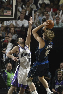 SACRAMENTO, CA - MAY 15:  Dirk Nowitzki #41 of the Dallas Mavericks takes a fallaway jump shot over Predrag Stojakovic #16 of the Sacramento Kings in Game six of the Western Conference Semifinals during the 2003 NBA Playoffs at Arco Arena on May 15, 2003