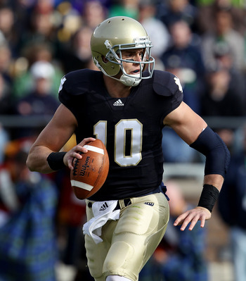 SOUTH BEND, IN - OCTOBER 30: Dayne Crist #10 of the Notre Dame Fighting Irish looks for a receiver against the Tulsa Golden Hurricane at Notre Dame Stadium on October 30, 2010 in South Bend, Indiana. Tulsa defeated Notre Dame 28-27. (Photo by Jonathan Dan
