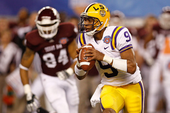 ARLINGTON, TX - JANUARY 07:  Jordan Jefferson #9 of the Louisiana State University Tigers looks to throw a pass during the game against the Texas A&amp;M Aggies during the AT&amp;T Cotton Bowl at Cowboys Stadium on January 7, 2011 in Arlington, Texas.  (Photo by