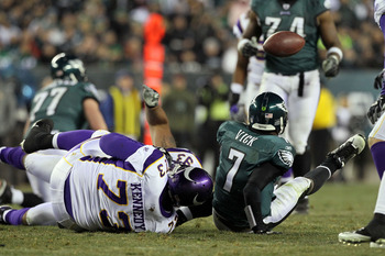 PHILADELPHIA, PA - DECEMBER 28:  Michael Vick #7 of the Philadelphia Eagles fumbles against Jimmy Kennedy #73 of the Minnesota Vikings at Lincoln Financial Field on December 26, 2010 in Philadelphia, Pennsylvania.  (Photo by Jim McIsaac/Getty Images)