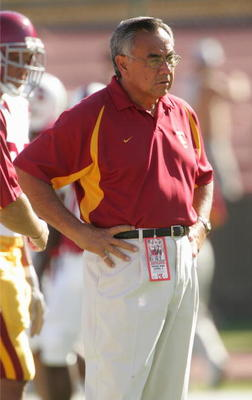 PALO ALTO, CA - SEPTEMBER 25:  Offensive coordinator Norm Chow of the USC Trojans watches the action on the field during the game against the Stanford Cardinal on September 25, 2004 at Stanford Stadium in Palo Alto, California.  USC defeated Stanford 31-2