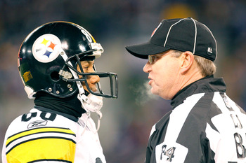 BALTIMORE, MD - DECEMBER 05:  Wide receiver Hines Ward #86 of the Pittsburgh Steelers talks to a referee during the game against the Baltimore Ravens at M&T Bank Stadium on December 5, 2010 in Baltimore, Maryland. Pittsburgh won 13-10.  (Photo by Geoff Bu