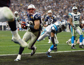 HOUSTON - FEBRUARY 1:  Mike Vrabel#50 of the New England Patriots scores a touchdown against the Carolina Panthers during Super Bowl XXXVIII at Reliant Stadium on February 1, 2004 in Houston, Texas.  The Patriots defeated the Panthers 32-29.  (Photo by An