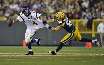 GREEN BAY, WI - OCTOBER 24:  Brett Favre #4 of the Minnesota Vikings has his jersey grabbed by Clay Matthews #52 of the Green Bay Packers at Lambeau Field on October 24, 2010 in Green Bay, Wisconsin. (Photo by Jim Prisching/Getty Images)