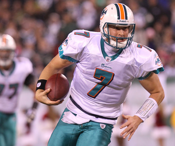 EAST RUTHERFORD, NJ - DECEMBER 12:  Chad Henne #7 of the Miami Dolphins scrambles from the pocket against the New York Jets at New Meadowlands Stadium on December 12, 2010 in East Rutherford, New Jersey.  (Photo by Nick Laham/Getty Images)