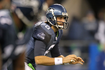 SEATTLE, WA - JANUARY 02:  Quarterback Charlie Whitehurst #6 of the Seattle Seahawks waits for the snap during their game against the St. Louis Rams at Qwest Field on January 2, 2011 in Seattle, Washington.  (Photo by Otto Greule Jr/Getty Images)