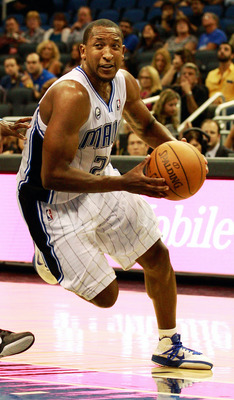 ORLANDO, FL - OCTOBER 10:  Chris Duhon #25 of the Orlando Magic drives toward the basket during the game against the New Orleans Hornets at Amway Arena on October 10, 2010 in Orlando, Florida. NOTE TO USER: User expressly acknowledges and agrees that, by