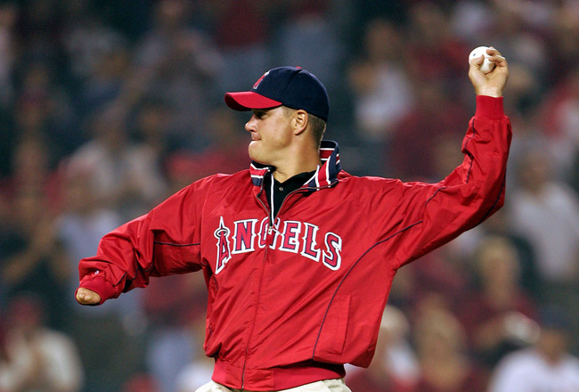 ANAHEIM, CA - OCTOBER 6:  Former pitcher Jim Abbott throws out the first pitch before the American League Division Series, Game Two between the Boston Red Sox and the Anaheim Angels on October 6, 2004 at Angels Stadium at Anaheim in Anaheim, California. (
