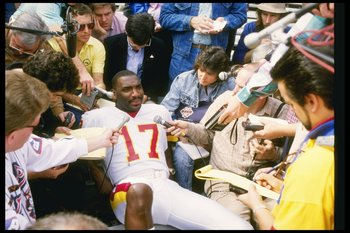 27 Jan 1988:  Quarterback Doug Williams of the Washington Redskins fields questions during Media Day for Super Bowl XXII against the Denver Broncos at Jack Murphy Stadium in San Diego, California.  The Redskins won the game, 42-10. Mandatory Credit: Mike