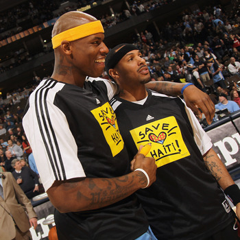DENVER, CO - JANUARY 13:  (L-R) Al Harrington #7 of the Denver Nuggets and Eddie House #55 of the Miami Heat show off their shirts as the teams warmed up in 'Save Haiti' shirts to promote the Haiti Relief Fund at the Pepsi Center on January 13, 2011 in De