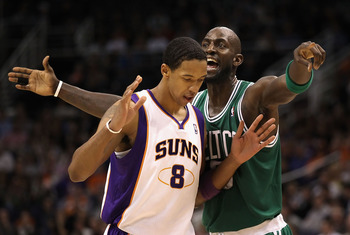 PHOENIX, AZ - JANUARY 28:  Kevin Garnett #5 of the Boston Celtics reacts to Channing Frye #8 of the Phoenix Suns during the NBA game at US Airways Center on January 28, 2011 in Phoenix, Arizona.  The Suns defeated the Celtics 88-71. NOTE TO USER: User exp