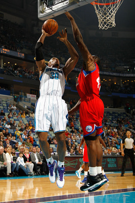 NEW ORLEANS, LA - JANUARY 03:  David West #30 of the New Orleans Hornets shoots over Elton Brand #42 of the Philadelphia 76ers in the first half at New Orleans Arena on January 3, 2011 in New Orleans, Louisiana. NOTE TO USER: User expressly acknowledges a