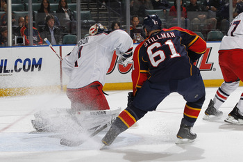 SUNRISE, FL - JANUARY 19: Cory Stillman #61 of the Florida Panthers scores a first-period goal past goaltender Steve Mason #1 of the Columbus Blue Jackets on January 19, 2011 at the BankAtlantic Center in Sunrise, Florida. (Photo by Joel Auerbach/Getty Im