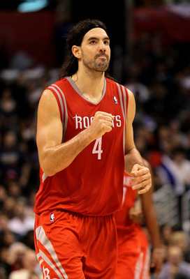 LOS ANGELES, CA - DECEMBER 22: Luis Scola #4 of the Houston Rockets celebrates after making a basket late in the fourth quarter against the Los Angeles Clippers at Staples Center on December 22, 2010 in Los Angeles, California.  The Rockets won 97-92. NOT