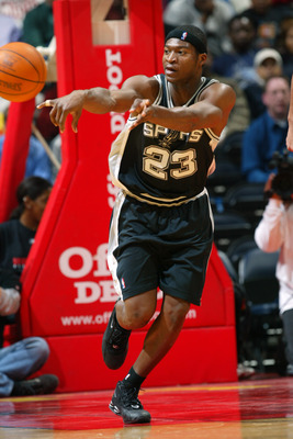 ATLANTA - JANUARY 13:  Devin Brown #23 of the San Antonio Spurs passes the ball during the game against the Atlanta Hawks at Philips Arena on January 13, 2004 in Atlanta, Georgia.  The Hawks won 86-77.  NOTE TO USER: User expressly acknowledges and agrees