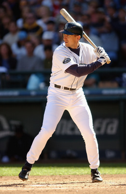SEATTLE - SEPTEMBER 22:  First Baseman John Olerud #5 of the Seattle Mariners readies at the plate against the Anaheim Angels during the game on September 22, 2002 at Safeco Field in Seattle, Washington.  The Mariners defeated the Angels 3-2.  (Photo by O